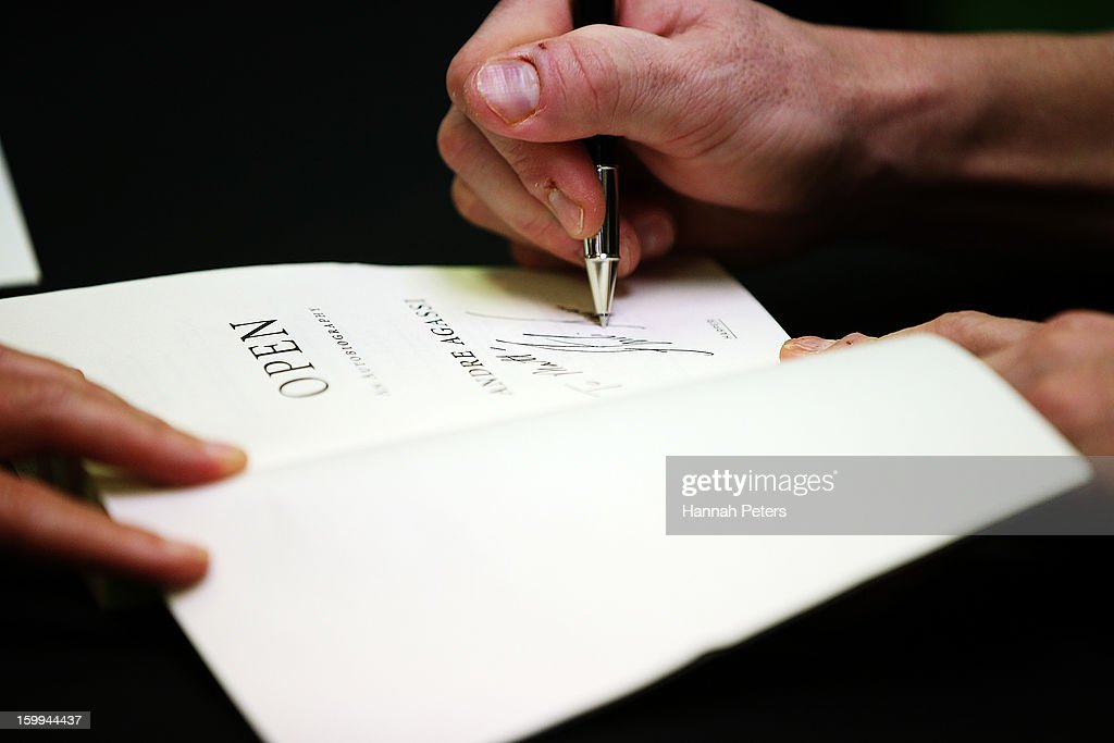 Andre Agassi signs copies of his autobiography, Open, at Paper Plus Newmarket on January 24, 2013 in Auckland, New Zealand.