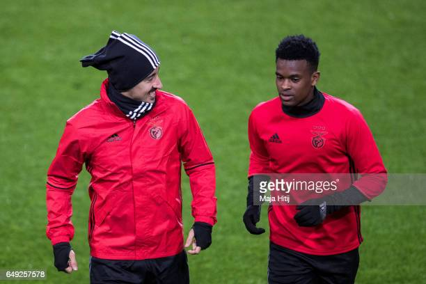 Andre Almeida and Nelson Semedo of Benfica warm up during the training prior the UEFA Champions League Round of 16 second leg match between Borussia...