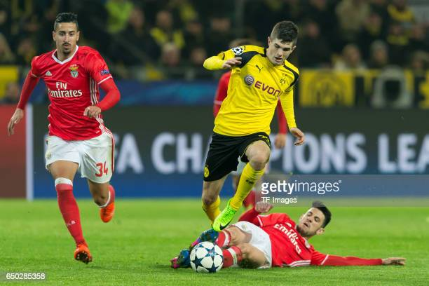 Andre Almeida of Benfica Christian Pulisic of Borussia Dortmund and Pizzi of Benfica battle for the ball during the UEFA Champions League Round of 16...
