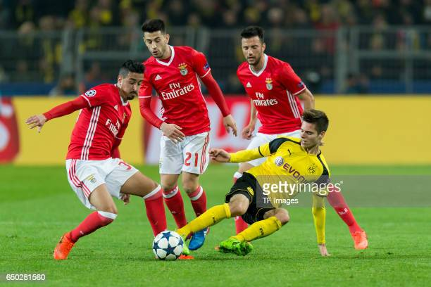 Andre Almeida of Benfica Pizzi of Benfica and Julian Weigl of Borussia Dortmund battle for the ball during the UEFA Champions League Round of 16...