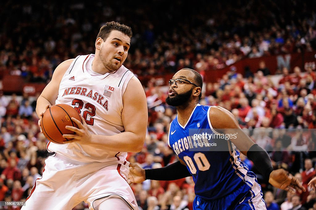 Andre Almeida #32 of the Nebraska Cornhuskers works against Gregory Echenique #0 of the Creighton Bluejays during their game at the Devaney Center on December 6, 2012 in Lincoln, Nebraska.