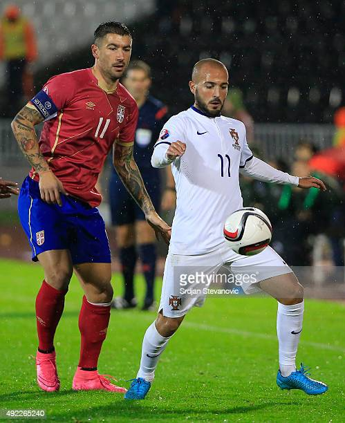 Andre Andre of Portugal in action against Aleksandar Kolarov of Serbia during the Euro 2016 qualifying football match between Serbia and Portugal at...