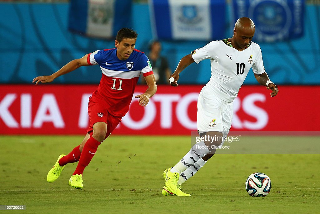 Andre Ayew of Ghana dribbles past <a gi-track='captionPersonalityLinkClicked' href=/galleries/search?phrase=Alejandro+Bedoya&family=editorial&specificpeople=6703886 ng-click='$event.stopPropagation()'>Alejandro Bedoya</a> of the United States during the 2014 FIFA World Cup Brazil Group G match between Ghana and the United States at Estadio das Dunas on June 16, 2014 in Natal, Brazil.