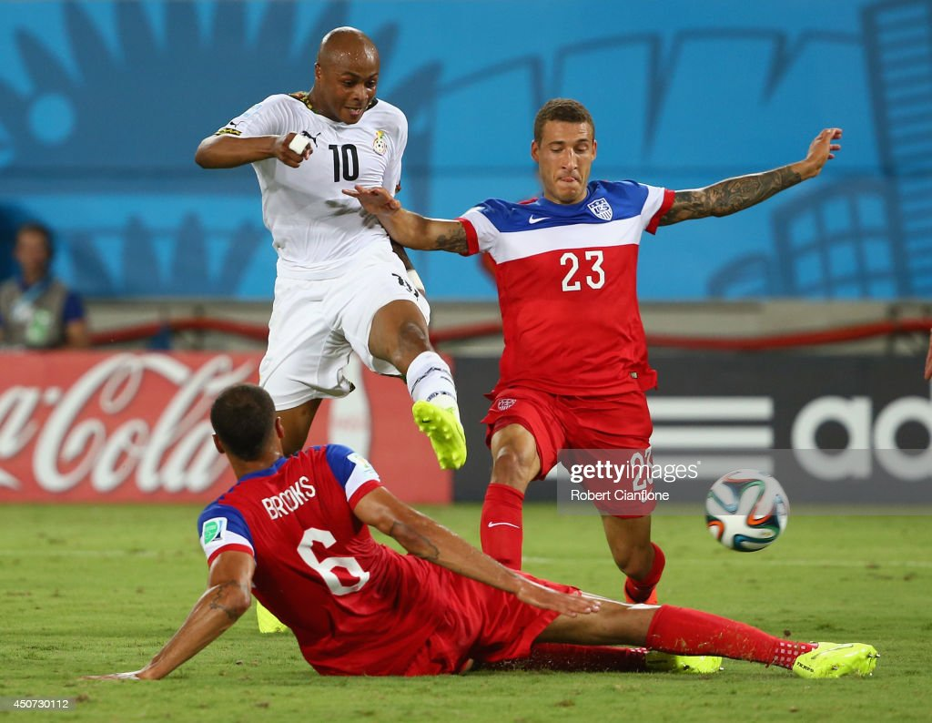 Andre Ayew of Ghana shoots and scores his team's first goal past John Brooks and <a gi-track='captionPersonalityLinkClicked' href=/galleries/search?phrase=Fabian+Johnson&family=editorial&specificpeople=677415 ng-click='$event.stopPropagation()'>Fabian Johnson</a> of the United States (R) during the 2014 FIFA World Cup Brazil Group G match between Ghana and the United States at Estadio das Dunas on June 16, 2014 in Natal, Brazil.