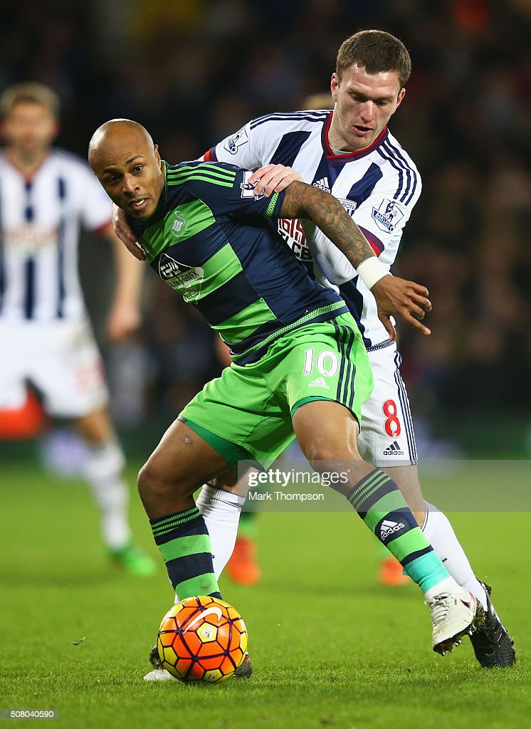 Andre Ayew of Swansea City and Craig Gardner of West Bromwich Albion compete for the ball during the Barclays Premier League match between West Bromwich Albion v Swansea City at The Hawthorns on February 2, 2016 in West Bromwich, England.