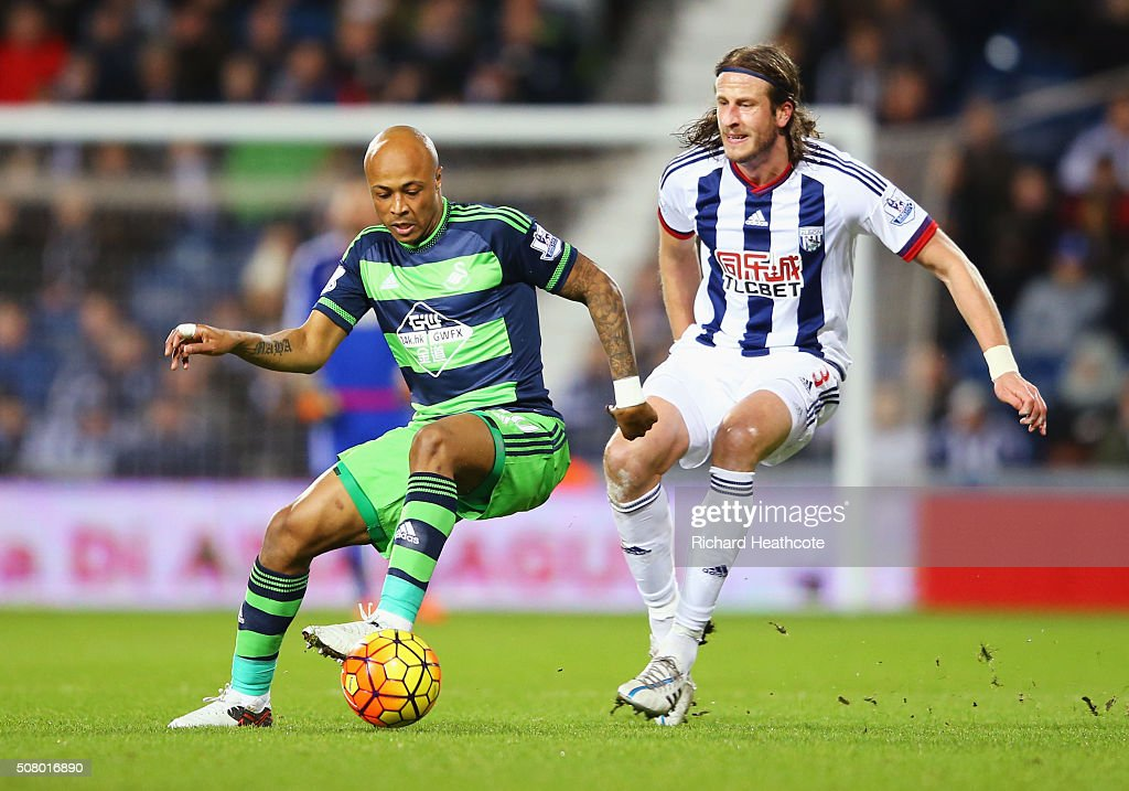 Andre Ayew of Swansea City and <a gi-track='captionPersonalityLinkClicked' href=/galleries/search?phrase=Jonas+Olsson&family=editorial&specificpeople=2855165 ng-click='$event.stopPropagation()'>Jonas Olsson</a> of West Bromwich Albion compete for the ball during the Barclays Premier League match between West Bromwich Albion and Swansea City at The Hawthorns on February 2, 2016 in West Bromwich, England.