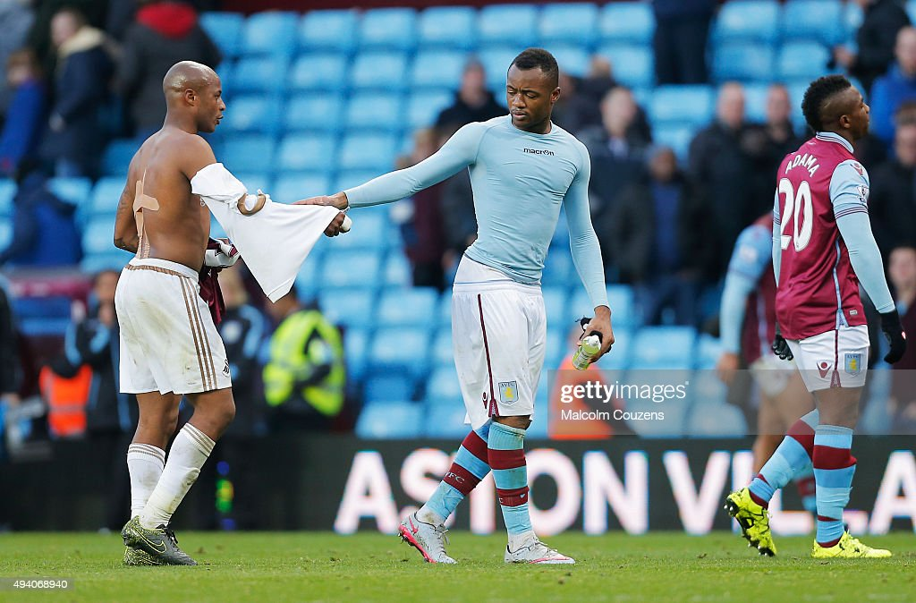 Andre Ayew of Swansea City and Jordan Ayew of Aston Villa shake hands after the Barclays Premier League match between Aston Villa and Swansea City at Villa Park on October 24, 2015 in Birmingham, England.