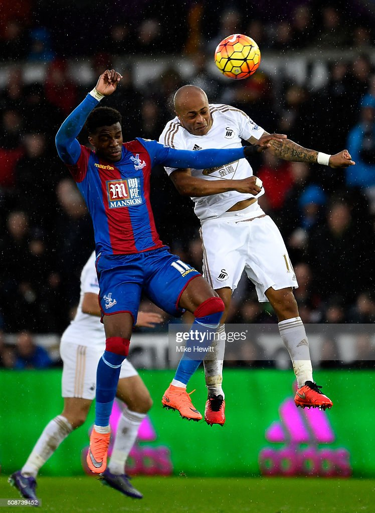 Andre Ayew of Swansea City and <a gi-track='captionPersonalityLinkClicked' href=/galleries/search?phrase=Wilfried+Zaha&family=editorial&specificpeople=7132531 ng-click='$event.stopPropagation()'>Wilfried Zaha</a> of Crystal Palace compete for the ball during the Barclays Premier League match between Swansea City and Crystal Palace at the Liberty Stadium on February 6, 2016 in Swansea, Wales.