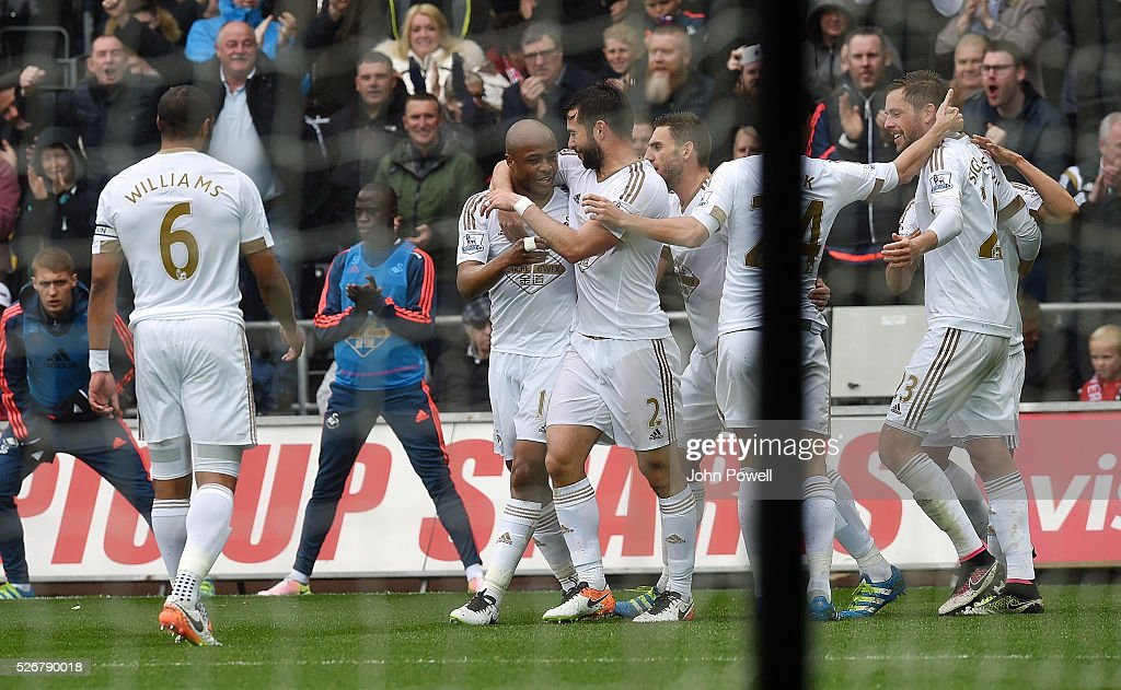 Andre Ayew of Swansea City celebrates after heading in the opening goal during a Premier League match between Swansea City and Liverpool at the Liberty Stadium on May 01, 2016 in Swansea, Wales.