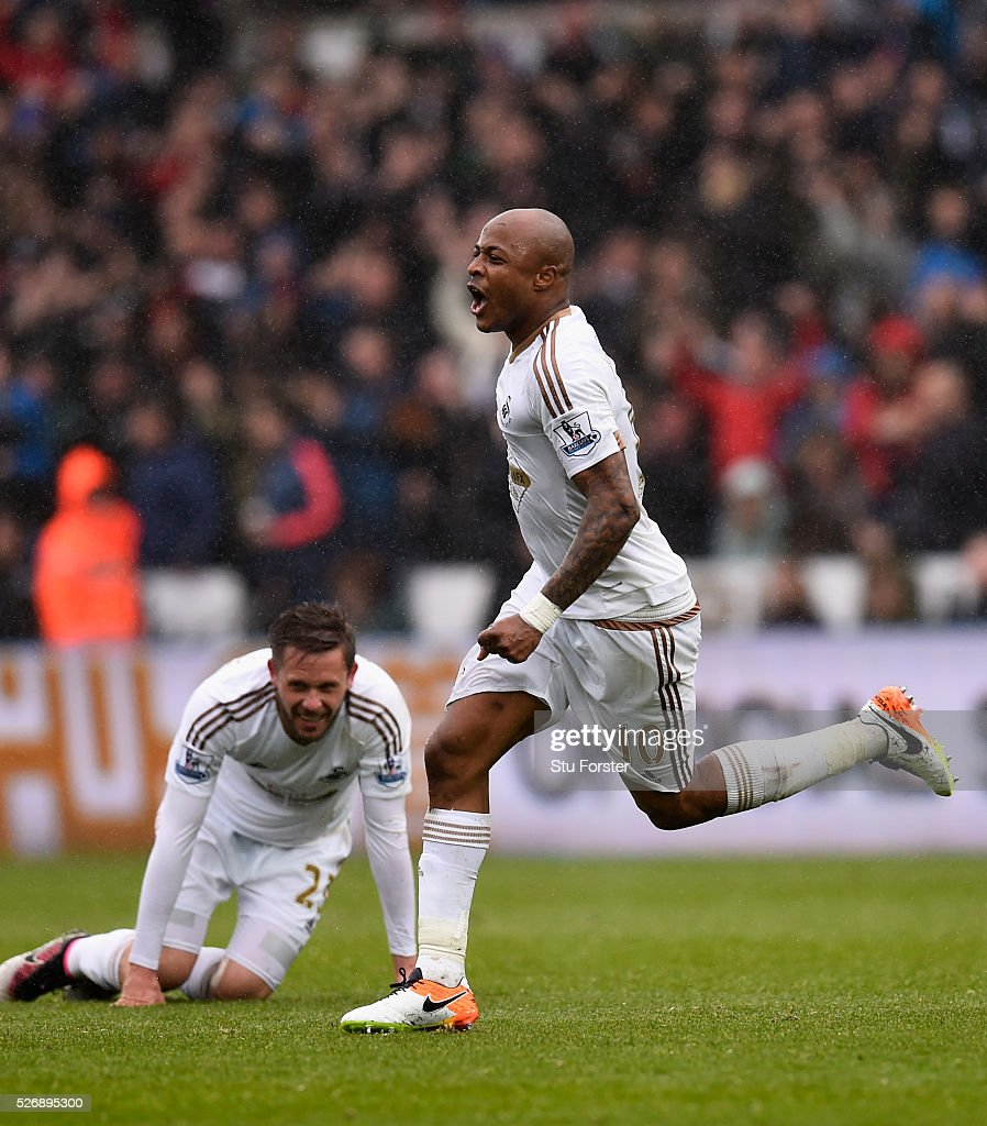 Andre Ayew (r) of Swansea City celebrates after scoring his team's third goal during the Barclays Premier League match between Swansea City and Liverpool at The Liberty Stadium on May 1, 2016 in Swansea, Wales.