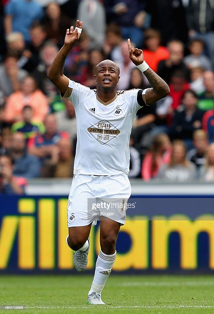 Andre Ayew of Swansea City celebrates scoring his team's second goal with his team mates during the Barclays Premier League match between Swansea City and Newcastle United at Liberty Stadium on August 15, 2015 in Swansea, United Kingdom.