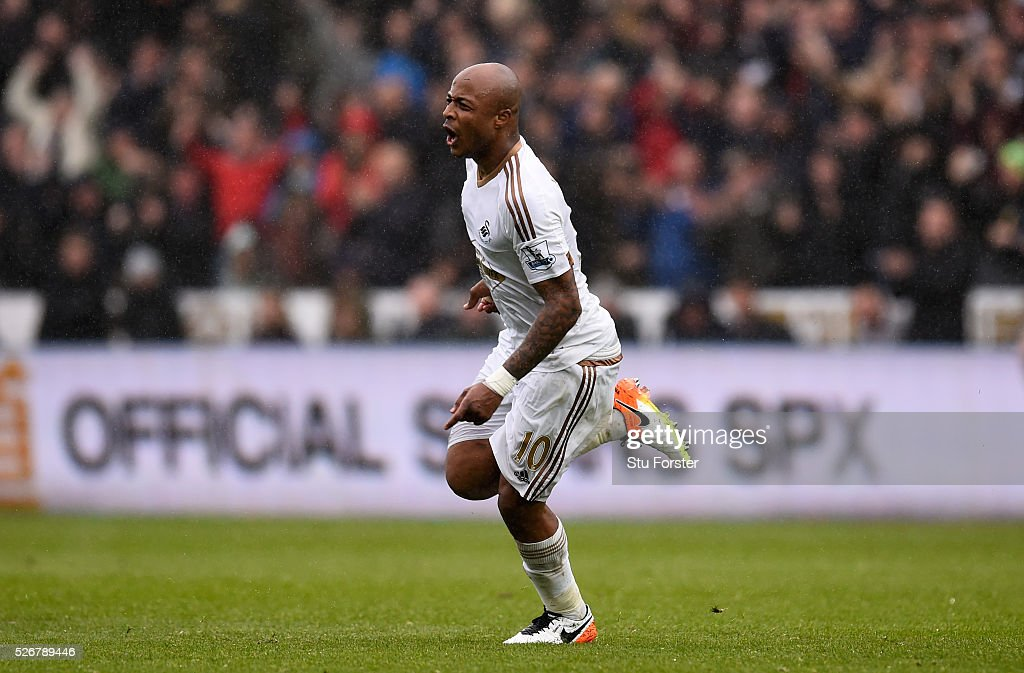 Andre Ayew of Swansea City celebrates scoring his team's third goal during the Barclays Premier League match between Swansea City and Liverpool at The Liberty Stadium on May 1, 2016 in Swansea, Wales.