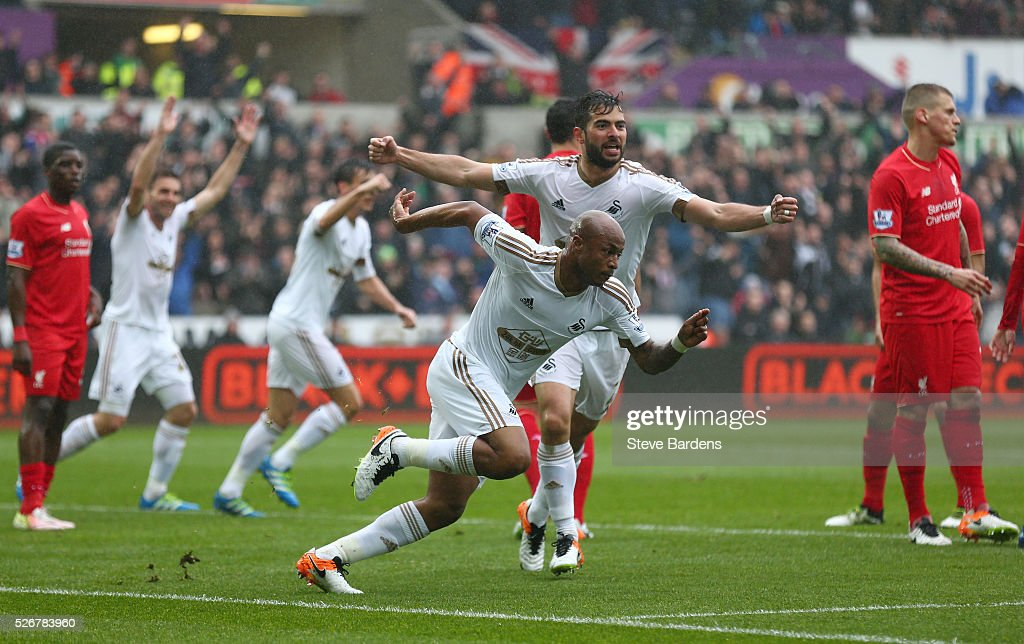 Andre Ayew of Swansea City celebrates scoring the opening goal during the Barclays Premier League match between Swansea City and Liverpool at The Liberty Stadium on May 1, 2016 in Swansea, Wales.