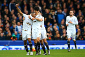 Andre Ayew of Swansea City celebrates with teammates after scoring his team's second goal during the Barclays Premier League match between Everton...