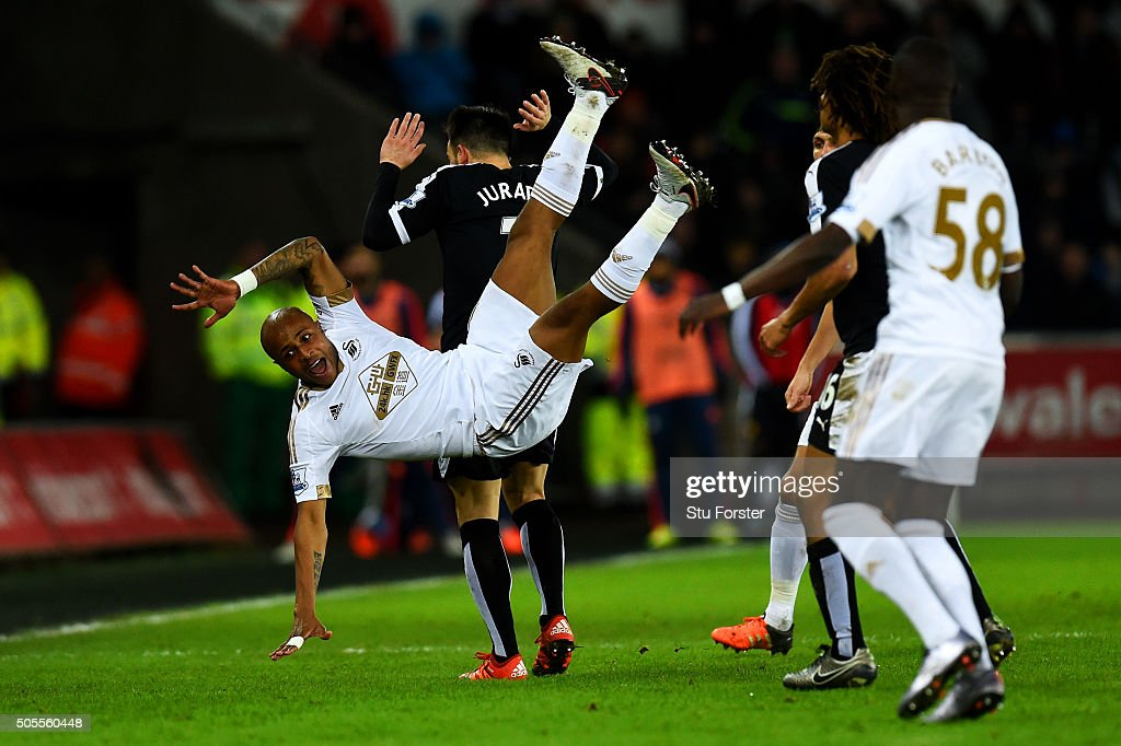 Andre Ayew of Swansea City clashes with <a gi-track='captionPersonalityLinkClicked' href=/galleries/search?phrase=Jose+Manuel+Jurado&family=editorial&specificpeople=4070797 ng-click='$event.stopPropagation()'>Jose Manuel Jurado</a> of Watford during the Barclays Premier League match between Swansea City and Watford at Liberty Stadium on January 18, 2016 in Swansea, Wales.