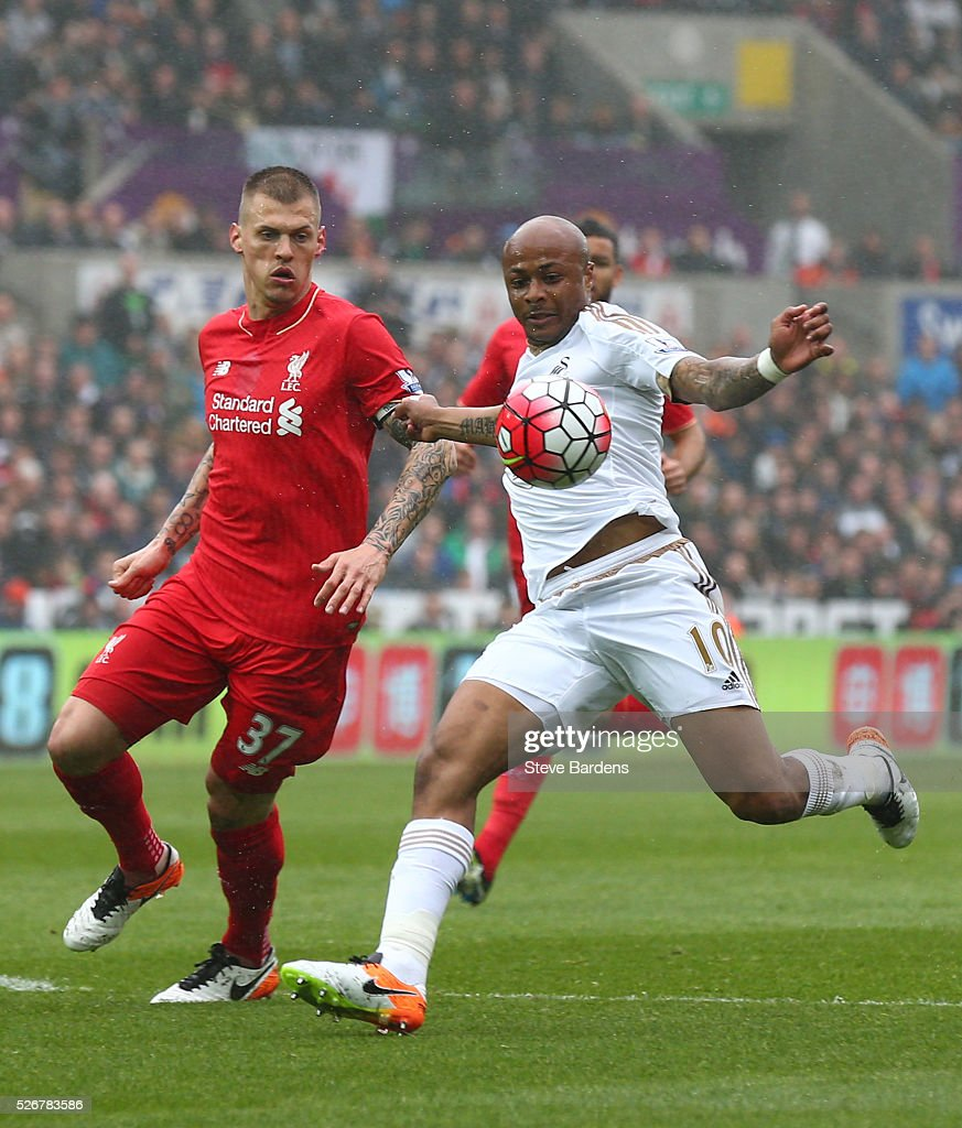 Andre Ayew of Swansea City is closed down by <a gi-track='captionPersonalityLinkClicked' href=/galleries/search?phrase=Martin+Skrtel&family=editorial&specificpeople=5554576 ng-click='$event.stopPropagation()'>Martin Skrtel</a> of Liverpool during the Barclays Premier League match between Swansea City and Liverpool at The Liberty Stadium on May 1, 2016 in Swansea, Wales.
