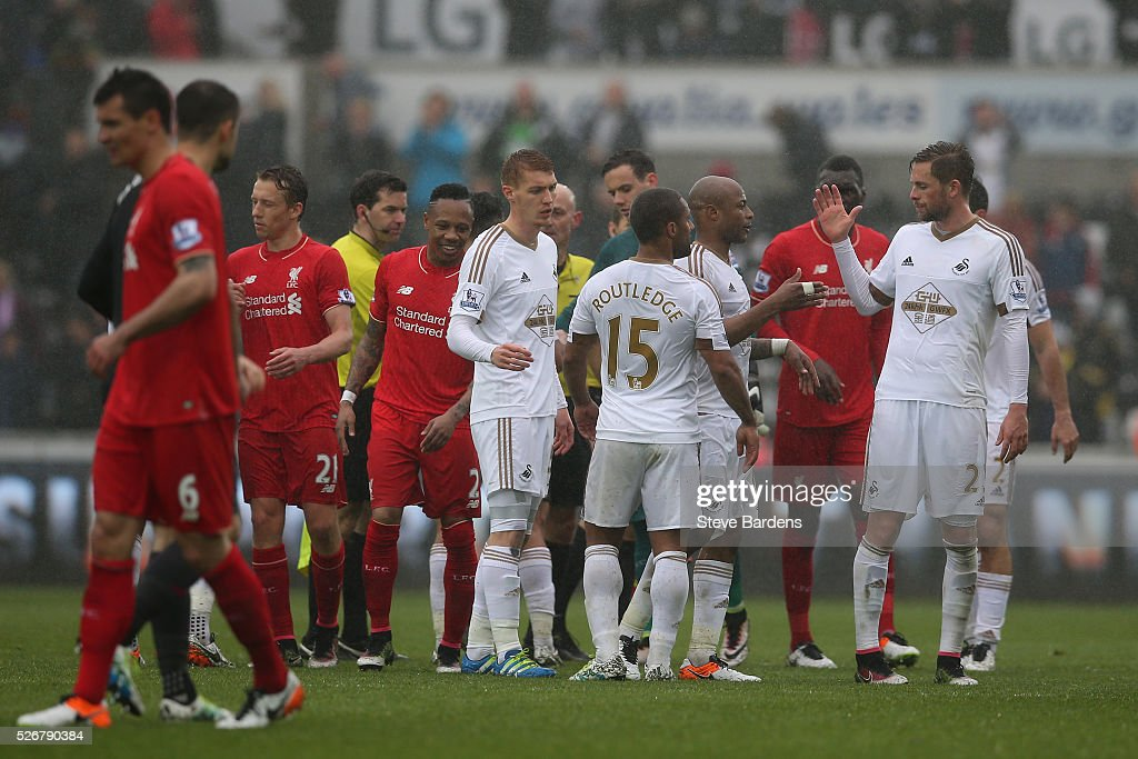 Andre Ayew of Swansea City is congratulated by team mates after the Barclays Premier League match between Swansea City and Liverpool at The Liberty Stadium on May 1, 2016 in Swansea, Wales.