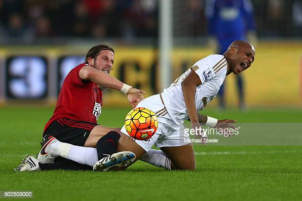Andre Ayew of Swansea City is tackled by Jonas Olsson of West Bromwich Albion during the Barclays Premier League match between Swansea City and West...