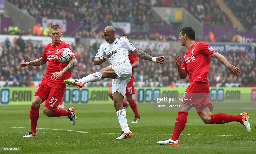 Andre Ayew of Swansea City misses an early chance at goal watched by Martin Skrtel (L) of Liverpool during the Barclays Premier League match between Swansea City and Liverpool at The Liberty Stadium on May 1, 2016 in Swansea, Wales.