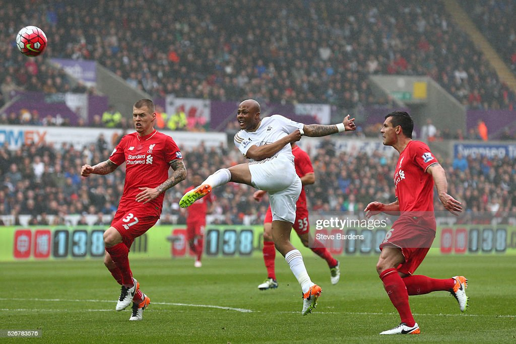 Andre Ayew of Swansea City misses an early chance at goal watched by <a gi-track='captionPersonalityLinkClicked' href=/galleries/search?phrase=Martin+Skrtel&family=editorial&specificpeople=5554576 ng-click='$event.stopPropagation()'>Martin Skrtel</a> (L) of Liverpool during the Barclays Premier League match between Swansea City and Liverpool at The Liberty Stadium on May 1, 2016 in Swansea, Wales.