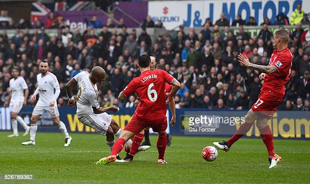 Andre Ayew of Swansea City scores his team's third goal during the Barclays Premier League match between Swansea City and Liverpool at The Liberty...