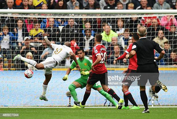 Andre Ayew of Swansea City scores past Sergio Romero of Manchester United during the Barclays Premier League match between Swansea City and...