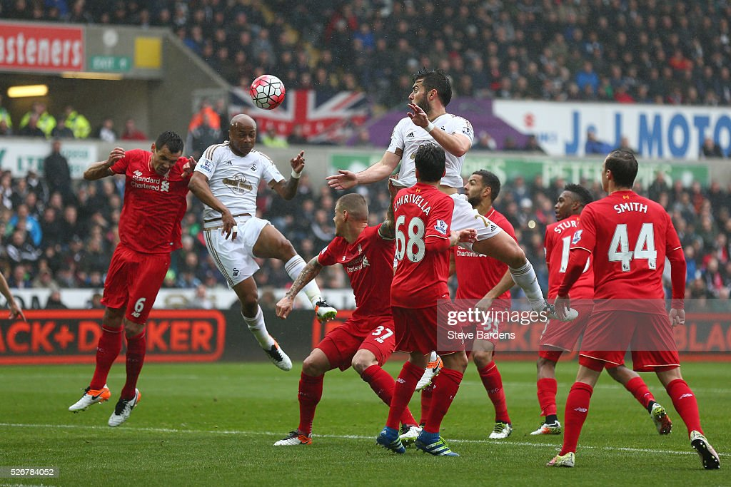 Andre Ayew of Swansea City scores the opening goal with a header during the Barclays Premier League match between Swansea City and Liverpool at The Liberty Stadium on May 1, 2016 in Swansea, Wales.