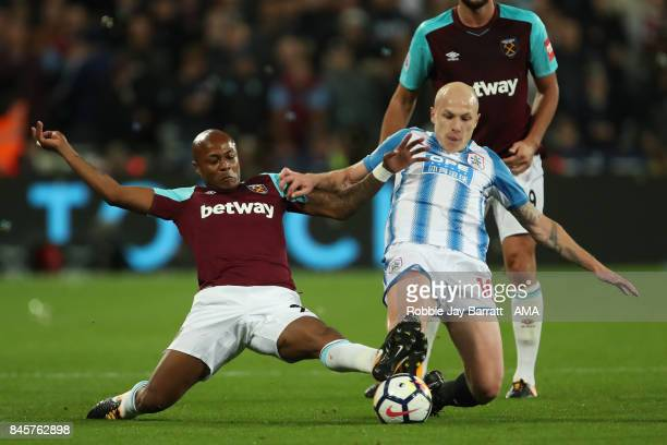 Andre Ayew of West Ham United and Aaron Mooy of Huddersfield Town during the Premier League match between West Ham United and Huddersfield Town at...
