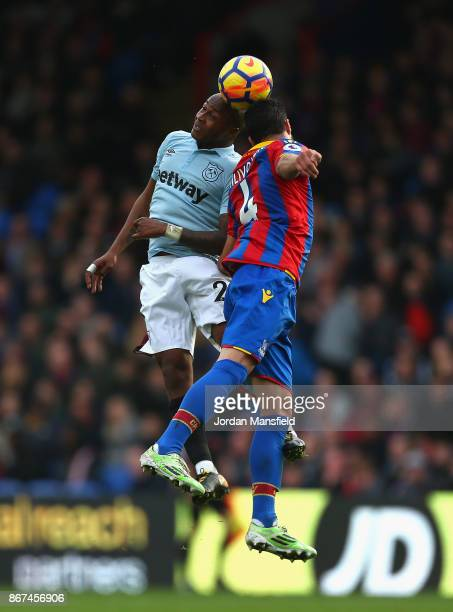 Andre Ayew of West Ham United and Luka Milivojevic of Crystal Palace battle for possession in the air during the Premier League match between Crystal...