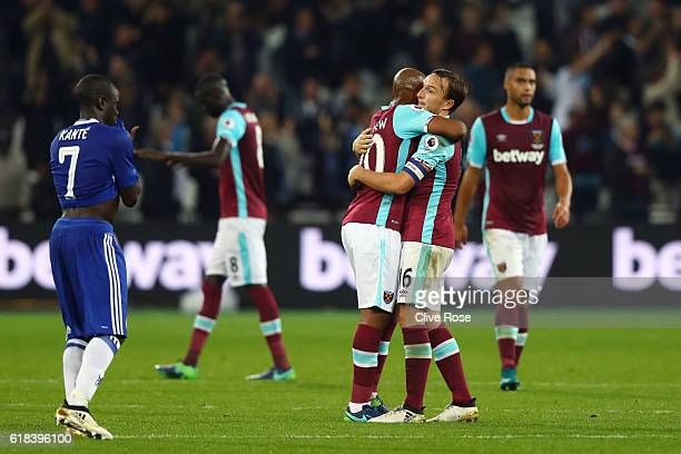 Andre Ayew of West Ham United and Mark Noble of West Ham United embrace after the final whistle during the EFL Cup fourth round match between West...
