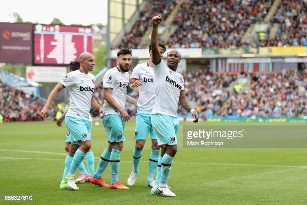 Andre Ayew of West Ham United celebrates scoring his sides second goal during the Premier League match between Burnley and West Ham United at Turf...