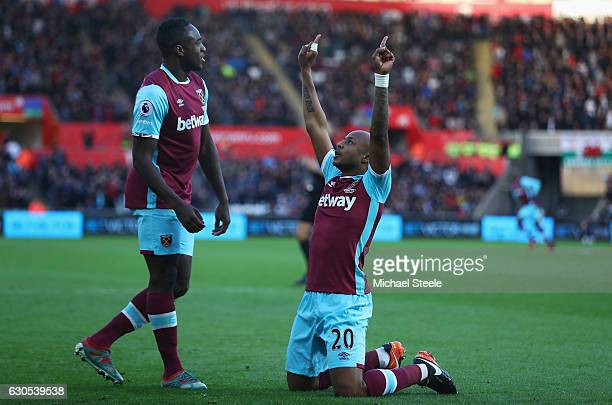 Andre Ayew of West Ham United celebrates scoring the opening goal with Michail Antonio of West Ham United during the Premier League match between...