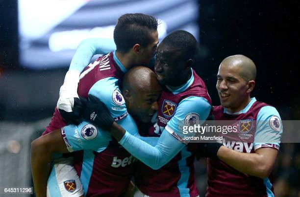 Andre Ayew of West Ham United celebrates with team mates after scoring his sides first goal during the Premier League match between Watford and West...