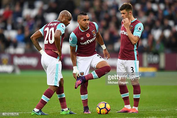Andre Ayew of West Ham United Dimitri Payet of West Ham United and Aaron Cresswell of West Ham United speak before a free kick during the Premier...