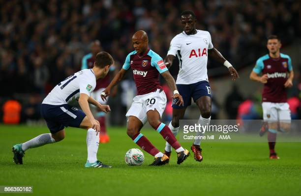 Andre Ayew of West Ham United is marked by Juan Foyth and Moussa Sissoko of Tottenham Hotspur during the Carabao Cup Fourth Round match between...