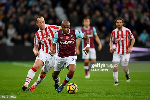 Andre Ayew of West Ham United is put under pressure from Glenn Whelan of Stoke City during the Premier League match between West Ham United and Stoke...