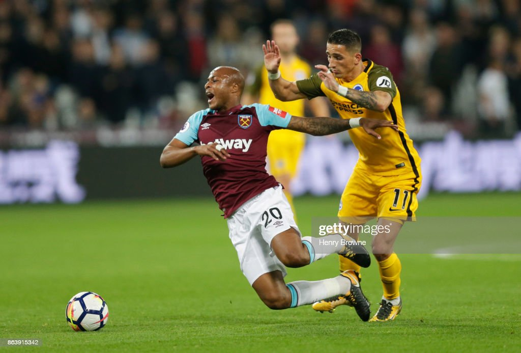 Andre Ayew of West Ham United is tripped by Anthony Knockaert of Brighton and Hove Albion during the Premier League match between West Ham United and Brighton and Hove Albion at London Stadium on October 20, 2017 in London, England.
