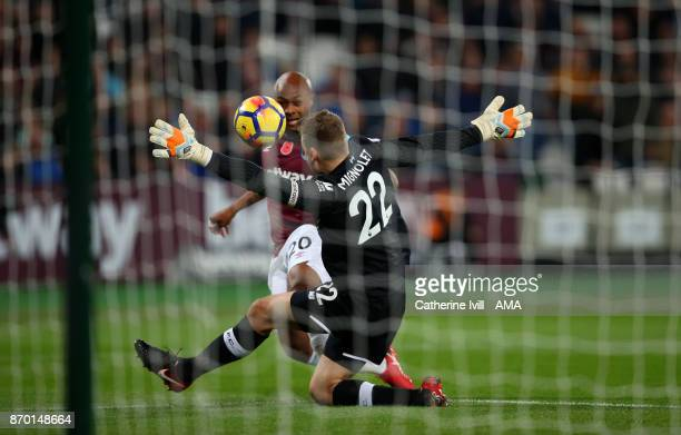 Andre Ayew of West Ham United sees his shot saved by Simon Mignolet of Liverpool during the Premier League match between West Ham United and...