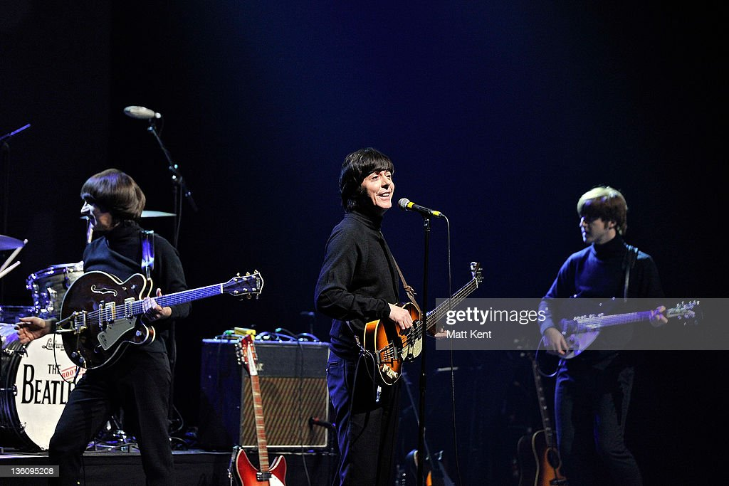 Andre Barreau (George Harrison), David Catlin-Birch (Paul McCartney) and Adam Hastings (John Lennon) of The Bootleg Beatles perform on stage at HMV Hammersmith Apollo on December 19, 2011 in London, United Kingdom.