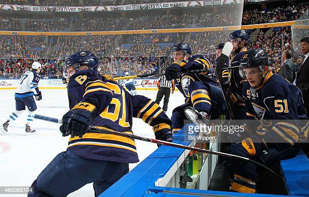 Andre Benoit and Rasmus Ristolainen of the Buffalo Sabres change on the fly against the Winnipeg Jets on November 26 2014 at the First Niagara Center...