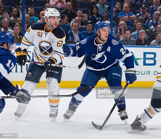 Andre Benoit of the Buffalo Sabres against Ryan Callahan of the Tampa Bay Lightning during the first period at the Amalie Arena on March 3 2015 in...