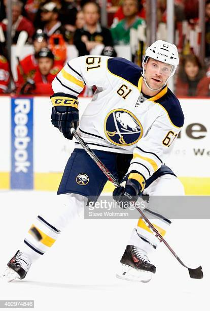 Andre Benoit of the Buffalo Sabres plays against the Chicago Blackhawks during the game at the United Center on October 11 2014 in Chicago Illinois