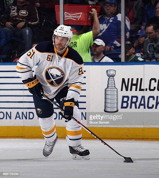 Andre Benoit of the Buffalo Sabres skates against the New York Islanders at the Nassau Veterans Memorial Coliseum on April 4 2015 in Uniondale New...