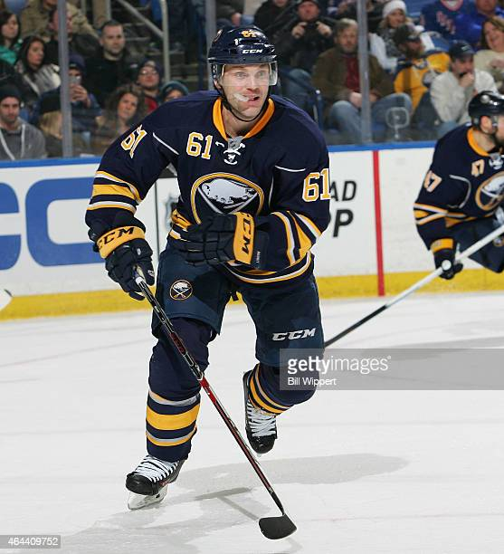 Andre Benoit of the Buffalo Sabres skates against the New York Rangers on February 20 2015 at the First Niagara Center in Buffalo New York
