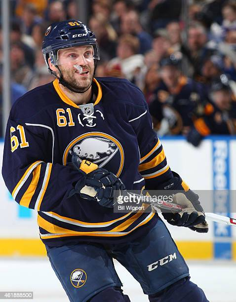 Andre Benoit of the Buffalo Sabres skates against the Philadelphia Flyers on January 17 2015 at the First Niagara Center in Buffalo New York