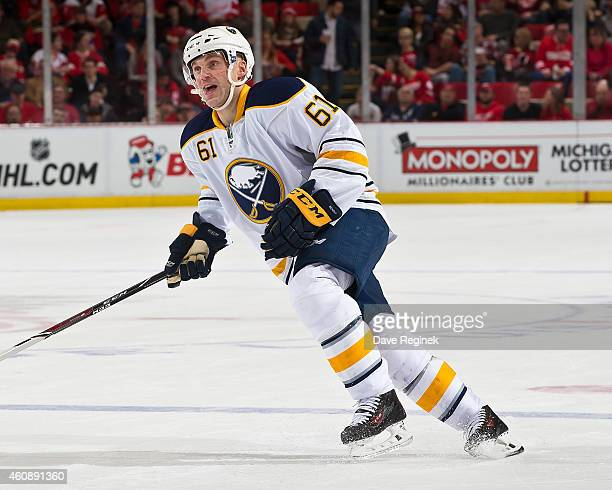 Andre Benoit of the Buffalo Sabres turns up ice against the Detroit Red Wings during a NHL game on December 23 2014 at Joe Louis Arena in Detroit...