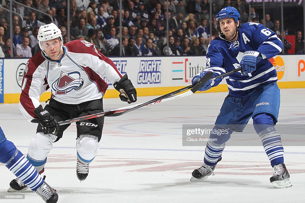 Andre Benoit #61 of the Colorado Avalanche is held up by <a gi-track='captionPersonalityLinkClicked' href=/galleries/search?phrase=David+Bolland&family=editorial&specificpeople=210850 ng-click='$event.stopPropagation()'>David Bolland</a> #63 of the Toronto Maple Leafs during an NHL game at the Air Canada Centre on October 8, 2013 in Toronto, Ontario, Canada.