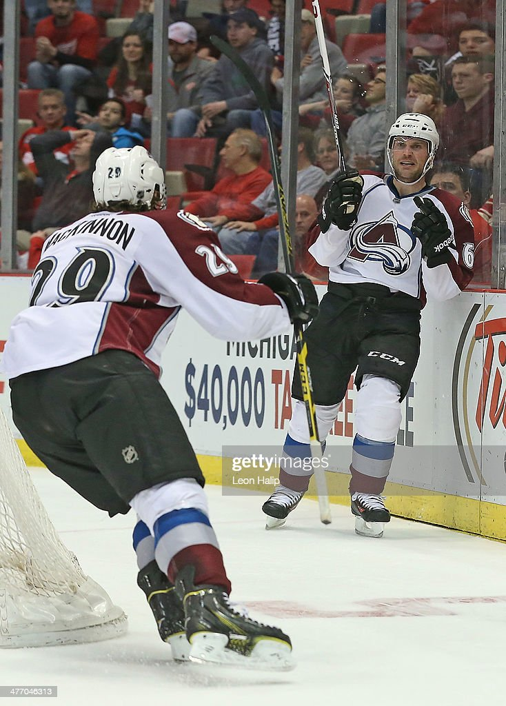Andre Benoit #61 of the Colorado Avalanche scores the game winning goal in overtime and celebrates with teammate <a gi-track='captionPersonalityLinkClicked' href=/galleries/search?phrase=Nathan+MacKinnon&family=editorial&specificpeople=8610127 ng-click='$event.stopPropagation()'>Nathan MacKinnon</a> #29 during the game against the Detroit Red Wings at Joe Louis Arena on March 6, 2014 in Detroit, Michigan. The Avalanch defeated the Wings 3-2 in overtime.