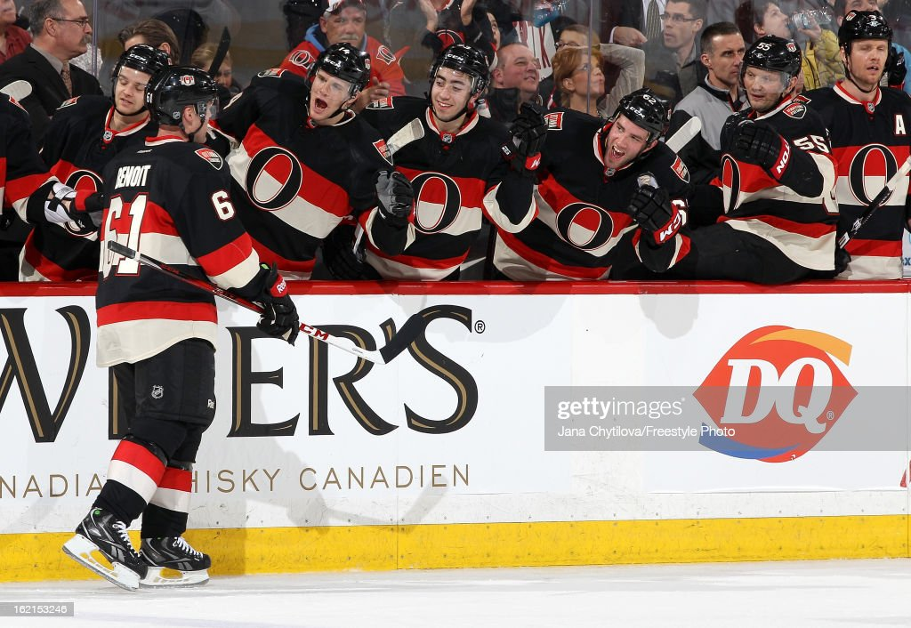 Andre Benoit #61 of the Ottawa Senators celebrates his first career NHL goal with team mates, during an NHL game against the New York Islanders at Scotiabank Place on February 19, 2013 in Ottawa, Ontario, Canada.