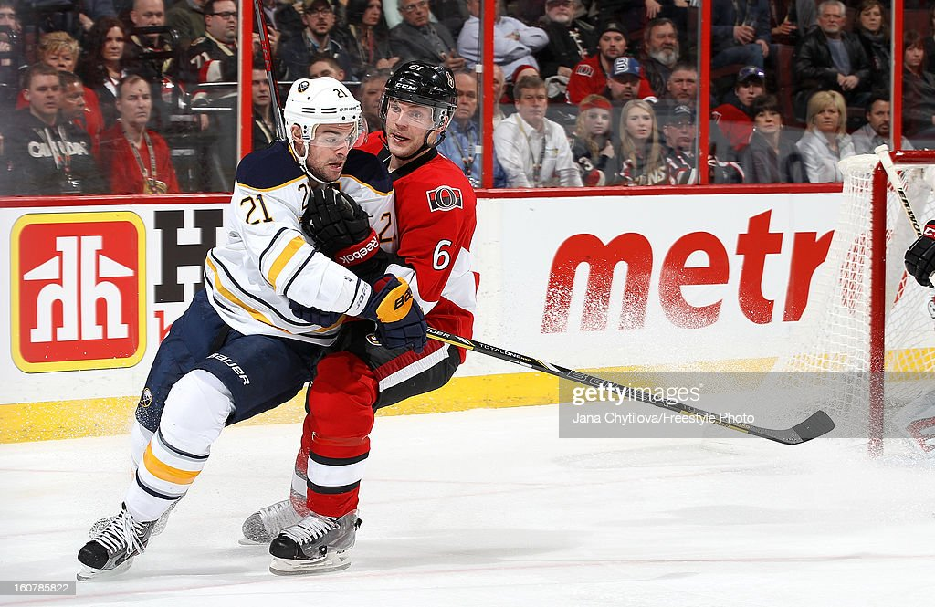 Andre Benoit #61 of the Ottawa Senators defends against <a gi-track='captionPersonalityLinkClicked' href=/galleries/search?phrase=Drew+Stafford&family=editorial&specificpeople=220617 ng-click='$event.stopPropagation()'>Drew Stafford</a> #21 of the Buffalo Sabres during an NHL game at Scotiabank Place on February 5, 2013 in Ottawa, Ontario, Canada.